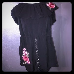 Ruffled Black romper with flower accents